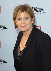 December 27, 2016 - File - CARRIE FRANCES FISHER (October 21, 1956 - December 27, 2016) was an American actress, screenwriter, author, producer, and speaker. She was known for playing Princess Leia in the Star Wars films. Fisher was also known for her semi-autobiographical novels, including Postcards from the Edge, and the screenplay for the film of the same name, as well as her autobiographical one-woman play, and its nonfiction book, Wishful Drinking, based on the show. Her other film roles included Shampoo (1975), The Blues Brothers (1980), Hannah and Her Sisters (1986), The 'Burbs (1989), and When Harry Met Sally (1989). Pictured: June 10, 2004; Hollywood, California, USA; Actress CARRIE FISHER at the 32nd AFI Life Achievement Awards held at the Kodak Theatre..  (Credit Image: Lisa O'Connor/ZUMAPRESS.com)