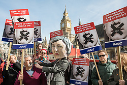 © Licensed to London News Pictures. 13/03/2017. London, UK. Campaigners calling for MPs to be given a 'meaningful' vote on the outcome of Brexit negotiations pose for a photograph in Parliament Square. The Article 50 bill will return to MPs in the Commons this afternoon. Photo credit: Rob Pinney/LNP