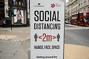 Social distancing sign on Regent Street Hands, face, space on 26th May 2021 in London, United Kingdom. As the coronavirus lockdown continues its process of easing restrictions, more and more people are coming to the West End as more businesses open.