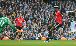 Manchester United's Paul Pogba (centre) scores his side's first goal of the game