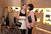NINE D'URSO; WITH HER MOTHER ; INES DE LA FRESSANGE, Cocktail party to launch the Miss Viv bag. ( Smash-and-grab raiders seized more than a dozen  of the handbags but they were recovered after the raiders crashed their motorbike and the bags spilled out onto the street. )<br /> Roger Vivier, 188 Sloane Street, London SW1,