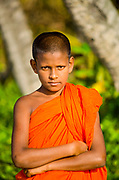 Young monk posing on Matara beach, Sri Lanka