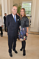 The HON.SIMON & MRS (REBECCA) HOWARD at a party to celebrate the 150th anniversary of Wartski held at The Orangery, Kensington Palace, London, on 19th May 2015.