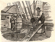 Coaling a boat, Hamburg, Germany. Steam ships had to carry enough coal in their holds to power their engines until they could reach the next port where they could refuel.  Engraving from 'Good Words' (London, 1893).