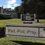 A sign of the times…The sign outside the United Methodist Church, Weston Road, Westport, Connecticut, USA, which reads IPad, IPod, IPray. 15th September 2013. Photo TIm Clayton