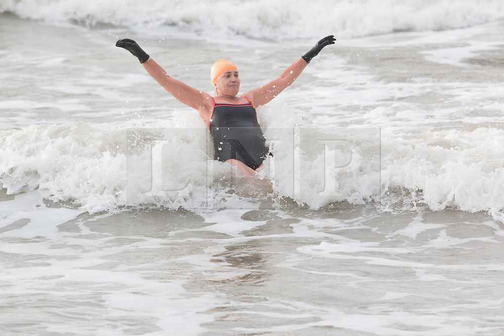 © Licensed to London News Pictures. 19/12/2015. Brighton, UK. Members of the Brighton and Hove sea swimming club take part in their daily exercise as the weather is hitting 14C. Today December 19th 2015. Photo credit: Hugo Michiels/LNP