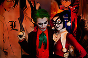 "James Bona & Celia Mitchard playing the Joker & his ""hench wench"" Harlequin (Harley Quin) from the movie Batman, attending the London Film and Comic Con LFCC is a convention held annually in London that focuses on films, cult television and comics. The convention holds a large dealers hall selling movie, comic and science fiction related memorabiliaand original film props, along with free guest talks, professional photoshoots, autograph sessions, displays. Many of the visitors / attendeesarrive dressed up as their favourite comic and sci-fi characters in the most outlandish costumes which draws from the award-winning formula of innovative gameplay."