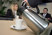 A meeting, the enjoyable alternative to work.<br /> A photograph of a coffee pot.