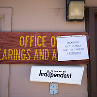 A new sign hangs outside the Office of Hearings and Appeals stating that maximum occupancy is not to exceed 4 persons.