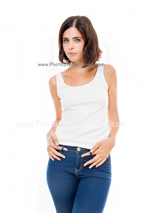young woman in jeans and white tank top on white background Model release available