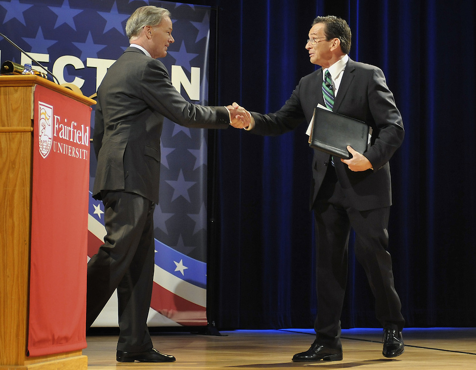 Republican candidate for governor Tom Foley, left, and Democratic candidate Dan Malloy shake hands after their debate at Fairfield University in Fairfield, Conn., Tuesday, Oct. 19, 2010.  (AP Photo/Jessica Hill)