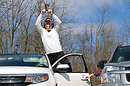 Mark Tripp, of Quakake, takes a photo while standing on his car as Bethany Wesleyan Church holds their Sunday worship service Mar. 22, 2020, at Becky's Drive-In in Walnutport, Pennsylvania. Concerns over the coronavirus have closed churches in an effort to avoid gatherings of large crowds.