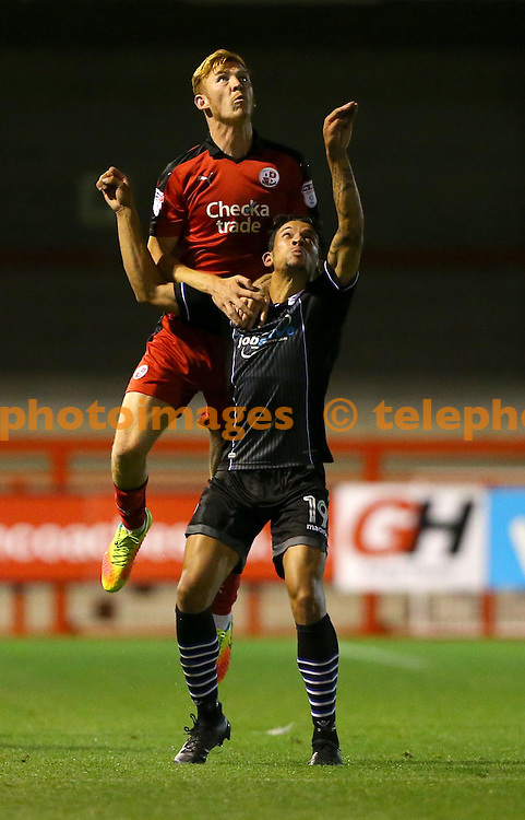 Crawley's Josh Yorwerth  challenges Macauley Bonne of Colchester during the Checkatrade Trophy match between Crawley Town and Colchester United at the Checkatrade Stadium in Crawley. August 30, 2016.<br /> James Boardman / Telephoto Images<br /> +44 7967 642437