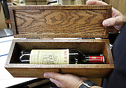 Dave Chaput, owner of the Live Oak Wine Decor business in Millstadt, with a custom-made box for a bottle. The box lid is engraved with the names of the bride and groom and date of the marriage.