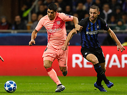 November 7, 2018 - Milan, Italy - Milan Skriniar (R) of Inter Milan and Luis Suarez of Barcelona vie for the ball during the Group B match of the UEFA Champions League between FC Internazionale and FC Barcelona on November 6, 2018 at San Siro Stadium in Milan, Italy. (Credit Image: © Mike Kireev/NurPhoto via ZUMA Press)