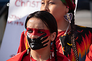 San Francisco, USA. 19th January, 2019. The Women's March San Francisco begins with a rally at Civic Center Plaza in front of City Hall. Missing and murdered indigenous women was a prominent theme at the march and rally. A group of Native American women dressed in red gathered as the rally began and also marched to bring attention to the issue in Northern California. Credit: Shelly Rivoli/Alamy Live News