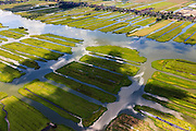 Nederland, Noord-Holland, Gemeente Wormerland, 14-06-2012; Polder Wormer, Jisp en Nek. De verkaveling in het gebied is het resultaat van veenontginning. Het water van 't Zwet loopt naar het dorp Jisp (links), boven in beeld de lintbebouwing van Wormer..Polder in provincie North Holland (above Amsterdam) with villages. The division in plots in the area is the result of peat extraction..luchtfoto (toeslag), aerial photo (additional fee required);.copyright foto/photo Siebe Swart