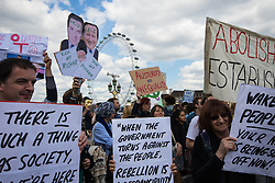 ter, London, May 30th 2015. Anti-austerity campaigners bring traffic on Westminster Bridge as they paint and hang a banner off the bridge highlighting an alleged £120 billion owed in taxes as compared to the proposed £12 billion cuts to welfare. PICTURED: Anti-Tory and anarchist placards highlight the dissatisfaction felt by some groups unhappy with the election results.