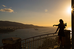 Sorrento, Italy, September 17 2017. As he sun sets a couple enjoy the view across the bay of Sorrento, southern Italy. © Paul Davey