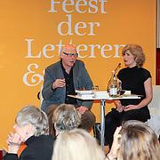 NLD/Amsterdam/20130309 - Feest der Letteren 2013 in de Bijenkorf te Amsterdam, Oek de Jong in gesprek met Mieke van der Weij