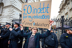 © Licensed to London News Pictures. 19/11/2016. LONDON, UK.   AARON PARR, from Queen Mary College, part of the University of London, dressed as Teresa May in front of Downing Street. Thousands of students march through central London to protest against tuition fees and recent Government plans to restrict student visas. Photo credit: Cliff Hide/LNP