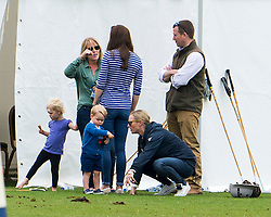 © Licensed to London News Pictures. 14/06/2015. Prince George of Cambridge and his mother Catherine Duchess of Cambridge talking to Autumn Phillips  and Daughter Savannah Phillips, with Zara Phillips and Peter Phillips . British Royals attend a charity Polo match in Tetbury,  Gloucestershire, UK. Photo credit: Ben Cawthra/LNP
