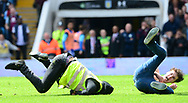 a steward falls flat on his face as he tries to stop an Aston Villa fan who  invades the pitch after Gabriel Agbonlahor scores a goal and makes it 1-0 . EFL Skybet championship match, Aston Villa v Birmingham city at Villa Park in Birmingham, The Midlands on Sunday 23rd April 2017.<br /> pic by Bradley Collyer, Andrew Orchard sports photography.