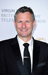 Adam Hills in the press room at the Virgin TV British Academy Television Awards 2017 held at Festival Hall at Southbank Centre, London. PRESS ASSOCIATION Photo. Picture date: Sunday May 14, 2017. See PA story SHOWBIZ Bafta. Photo credit should read: Ian West/PA Wire