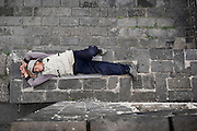 "A Chinese food vendor takes a rest on the Great Wall touristic spot of Jinshanling near Beijing, China, July 22, 2014. <br /> <br /> This image is part of the series ""24/7"", an ironic view on restless and fast-growing Chinese economy described through street vendors and workers sleeping during their commercial daily activity. <br /> <br /> © Giorgio Perottino"