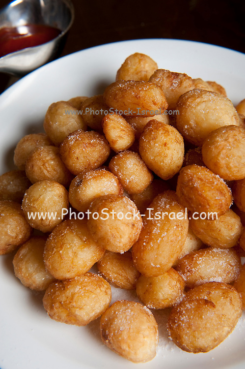 A plate of baked mini potatoes