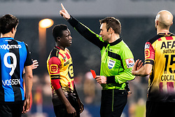 referee Nicolas Laforge gives a red card to Hassane Bande of KV Mechelen during the Jupiler Pro League match between KV Mechelen and Club Brugge on December 20, 2017 at the AFAS stadium in Mechelen, Belgium.