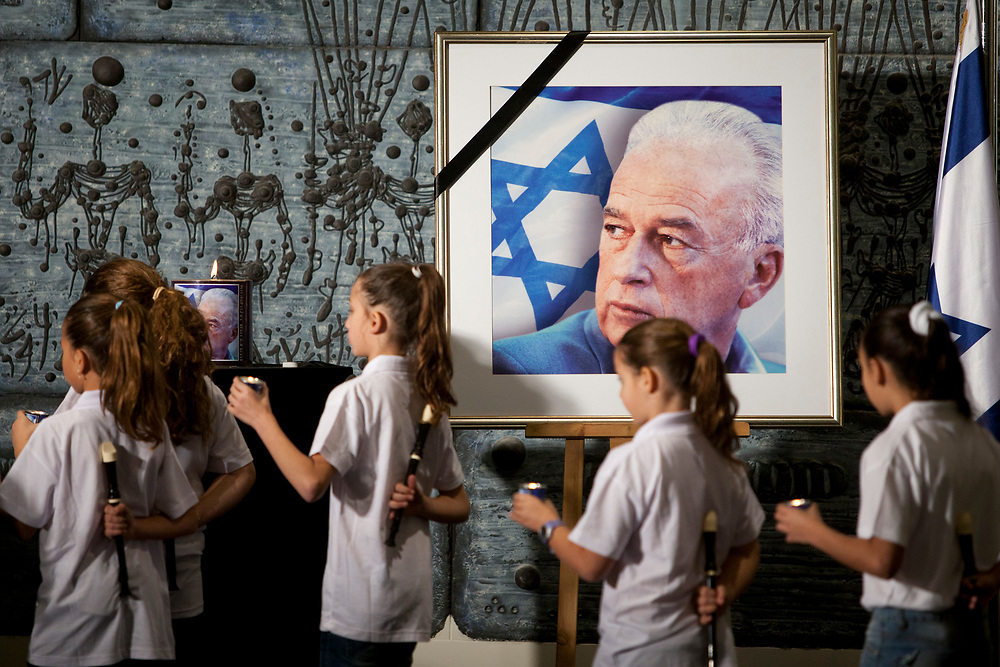 Israeli school children hold candles as they walk past a picture of assassinated Israeli Prime Minister Yitzhak Rabin, during a memorial ceremony marking the 16th anniversary of Rabin's assassination, at the President's Residence in Jerusalem, Israel, on November 08, 2011. Rabin was shot and killed by a right-wing Jewish extremist on November 4, 1995.