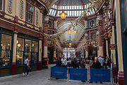 Although most City workers are still working from home, others enjoy Friday evening drinks at Leadenhall Market whose bars and restaurants have recently re-opened during the Coronavirus pandemic lockdown, on 21st August 2020, in London, England.