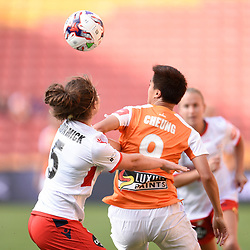 BRISBANE, AUSTRALIA - NOVEMBER 17: Cheung Wai Ki of the Roar ad Jenna McCormick of Adelaide compete for the ball during the round 4 Westfield W-League match between the Brisbane Roar and Adelaide United at Suncorp Stadium on November 17, 2017 in Brisbane, Australia. (Photo by Patrick Kearney / Brisbane Roar)