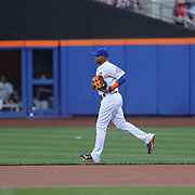 Yoenis Cespedes, New York Mets, heads out to left field during the New York Mets Vs Washington Nationals. MLB regular season baseball game at Citi Field, Queens, New York. USA. 1st August 2015. (Tim Clayton for New York Daily News)