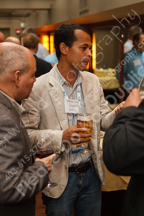 June 13, 2012, Calgary, AB - Guests and employees of Omega Well mix and mingle at an industry event during the 2012 Global Petroleum Show in Calgary, Alberta. The event was both a reception for the guests but also the official announcement of a name change for Omega Well Monitoring (formerly Canada Tech Well Monitoring)...©2012, Sean Phillips.http://www.RiverwoodPhotography.com