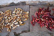 Chillies drying outside a farmhouse in Gorgona village, Bhutan