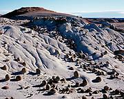 Sandstone bowling balls eroded from rolling badlands of the Fruitland Formation, Bisti Badlands, Bisti/De-Na-Zin Wilderness, San Juan Basin, New Mexico.