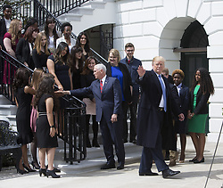 April 27, 2018 - Washington, District of Columbia, United States of America - United States President Donald J. Trump and US Vice President Mike Pence pose for photos with 2018 White House Correspondents Association Scholarship Winners at The White House in Washington, DC, April 27, 2018..Credit: Chris Kleponis / Pool via CNP (Credit Image: © Chris Kleponis/CNP via ZUMA Wire)