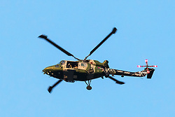 © Licensed to London News Pictures. 16/01/2018. London, UK. One of the last four remaining British Army Lynx helicopters flying in formation over central London. The British made aircraft is being decommissioned after almost 40 years in service. Photo credit: Rob Pinney/LNP