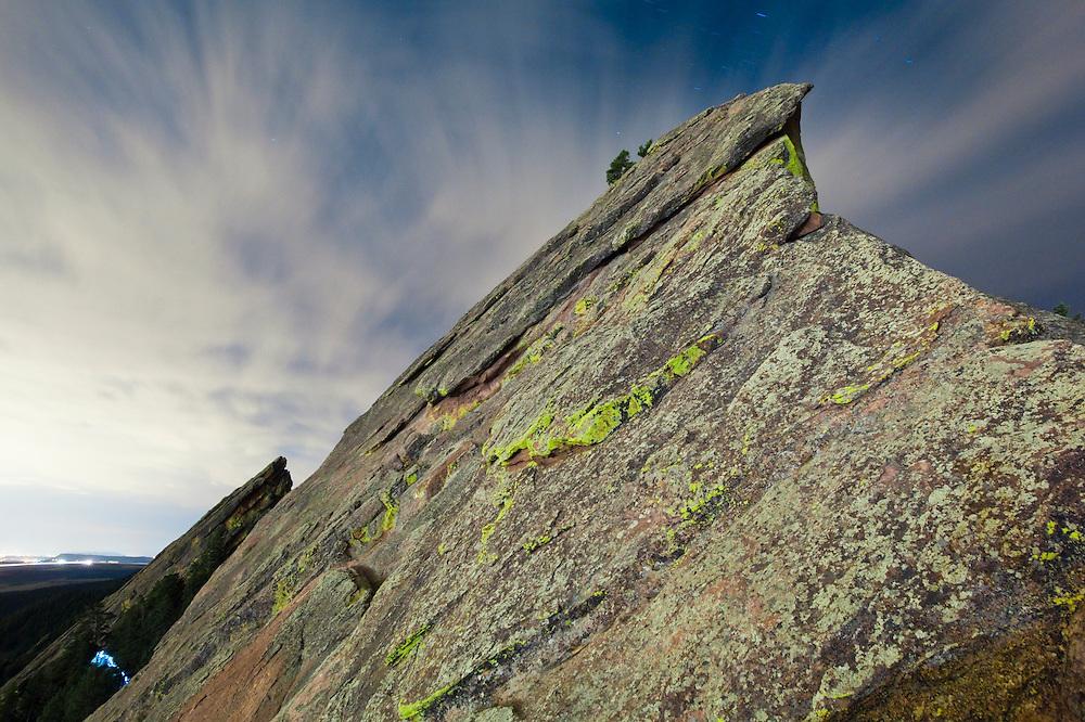 Summit ridge of the First Flatiron at night above Boulder, Colorado.