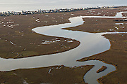 Aerial view of marsh and Rat Island Creek looking at Folly Beach in Charleston, SC.