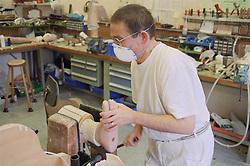Prosthetic workshop; manufacturing belowknee limbs,