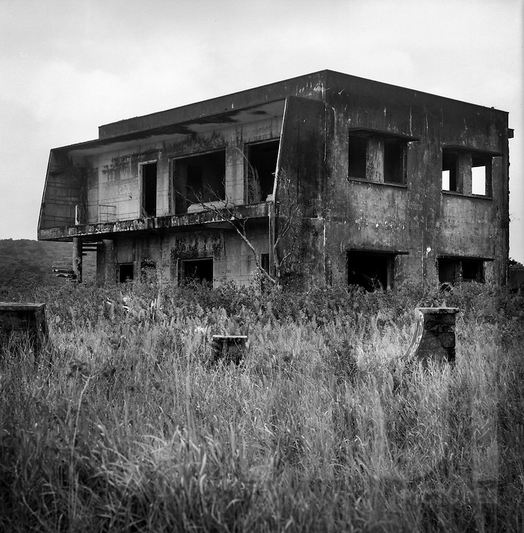 Dilapidated building in a meadow on the grounds of Bokor Hill Station, Preah Monivong National Park, Bokor, Kampot, Cambodia, 2005, Southeast Asia
