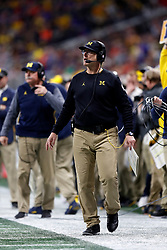 Michigan Wolverines head coach Jim Harbaugh looks on during the Chick-fil-A Peach Bowl, Saturday, December 29, 2018, in Atlanta. ( Paul Abell via Abell Images for Chick-fil-A Peach Bowl)