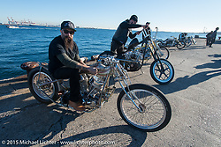 """Ryan Grossman with his 1948 HD Panhead known as Dean """"The Dean"""" Lanza's Quicksilver dual-carbed Panhead """"Show Dragster"""" at the local docks before the Mooneyes Yokohama Hot Rod & Custom Show. Yokohama, Japan. December 5, 2015.  Photography ©2015 Michael Lichter."""