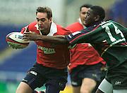 Reading. United Kingdom.   Rugby. England vLondon Irish vs Gloucester Rugby Gloucester full back, Jon Goodridge  tries to pass London Irish wing Paul Sackey.  [Mandatory Credit; Peter Spurrier/Intersport Images]
