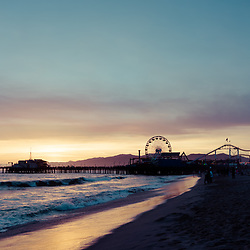 Santa Monica Pier beach sunset retro photo along the Pacific Ocean. Santa Monica is a coastal beach city in Southern California in the United States. Copyright ⓒ 2017 Paul Velgos with All Rights Reserved.