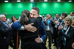 © Licensed to London News Pictures . 13/12/2019. Bury, UK. CHRISTIAN WAKEFORD hugs his wife ALEXANDRA as he celebrates the Conservative Party's win in Bury South , at the count for seats in the constituencies of Bury North and Bury South in the 2019 UK General Election , at Castle Leisure Centre in Bury . Photo credit: Joel Goodman/LNP