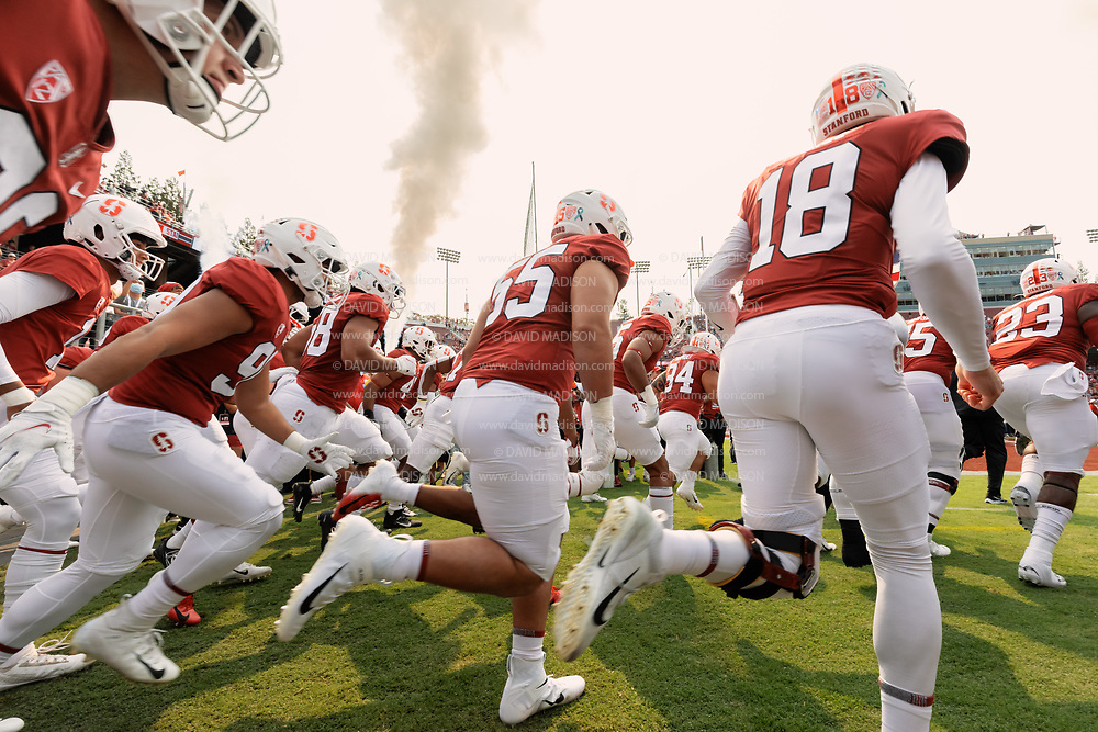 PALO ALTO, CA - SEPTEMBER 26:  Members of the Stanford Cardinal run onto the field at the start of  an NCAA Pac-12 college football game against the UCLA Bruins on September 26, 2021 at Stanford Stadium in Palo Alto, California; visible players include quarterback Tanner McKee #18.  (Photo by David Madison/Getty Images)